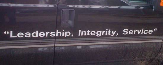 Slogan printed on the side of a truck with incorrect punctuation.