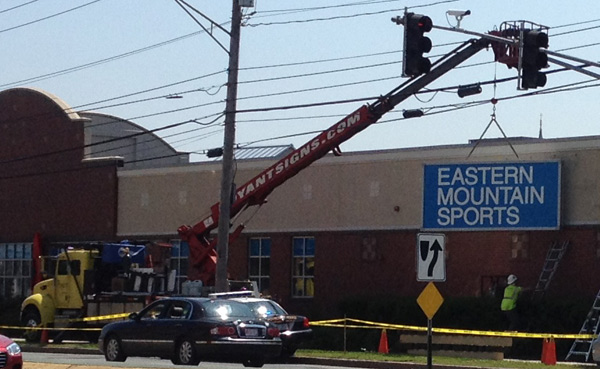 Installation of the new sign and logo at Eastern Mountain Sports